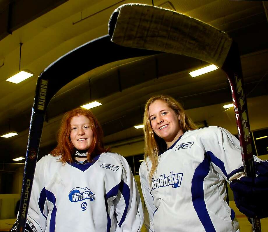 Darien High School hockey players, Madeline Coburn, left, and Aimee Rich, right,  two of the three captains for the DHS team,  posed at Twins Rinks in Stamford. Photo: Bob Luckey / Stamford Advocate
