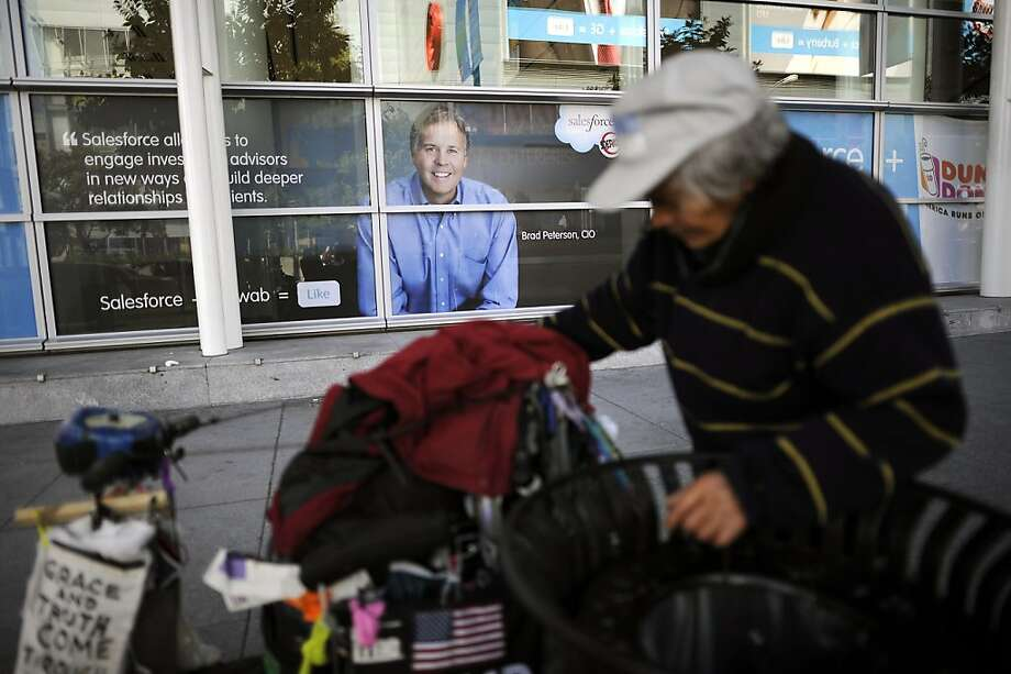 Tom Quiblat, who has been homeless for 10 years, looks for cans outside the Dreamforce conference. Photo: Michael Short, Special To The Chronicle