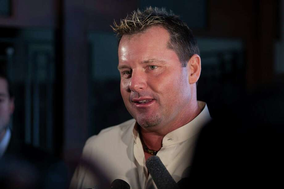 Roger Clemens talks with reporters before the Astros Legends Luncheon. Photo: Nathan Lindstrom / ©2012 Nathan Lindstrom