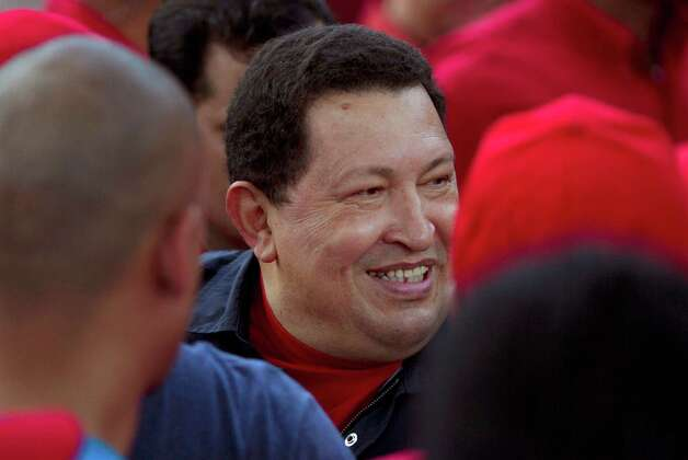 Venezuela's President Hugo Chavez smiles to supporters during a campaign rally in Propatria neighborhood, Caracas, Venezuela, Sept. 17, 2012. Venezuela's presidential election is scheduled for Oct. 7. (AP Photo/Ariana Cubillos) Photo: Ariana Cubillos, Associated Press / AP