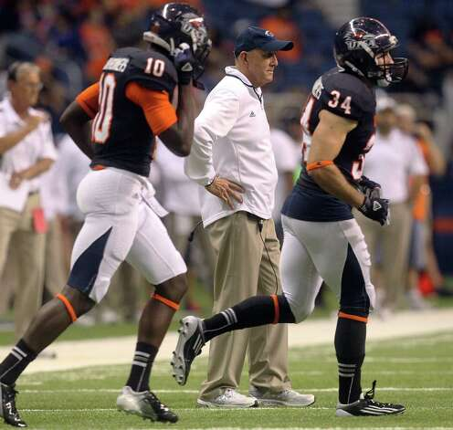 UTSA head coach Larry Coker watches players take the field against Northwestern Oklahoma State at the Alamodome on Saturday, Sept. 22, 2012. UTSA won 56-3. Photo: Kin Man Hui, Express-News / ©2012 San Antonio Express-News