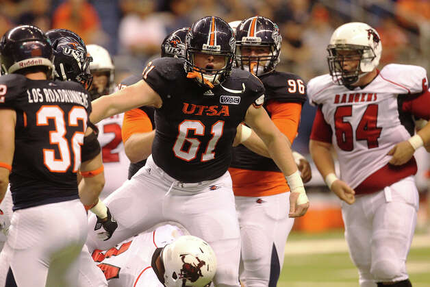 UTSA's Richard Burge (61) after a tackle against Northwestern Oklahoma State at the Alamodome on Saturday, Sept. 22, 2012. Photo: Kin Man Hui, Express-News / ©2012 San Antonio Express-News