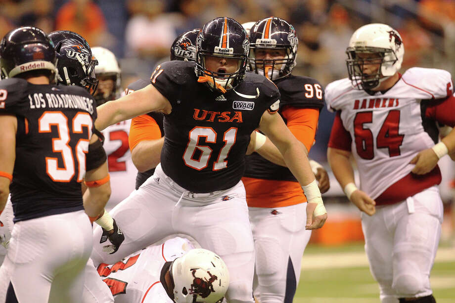 UTSA 56 - Northwestern Oklahoma St. 3: UTSA's Richard Burge (61) after a tackle against Northwestern Oklahoma State at the Alamodome on Saturday, Sept. 22, 2012. Photo: Kin Man Hui, Express-News / ©2012 San Antonio Express-News