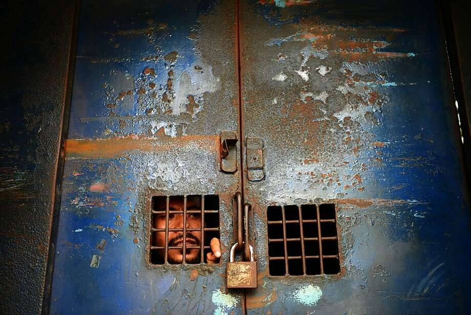 A Bangladeshi activist in Dhaka is held in a prison van after protesting the film that's roiling Muslims. Photo: Munir Uz Zaman, AFP/Getty Images