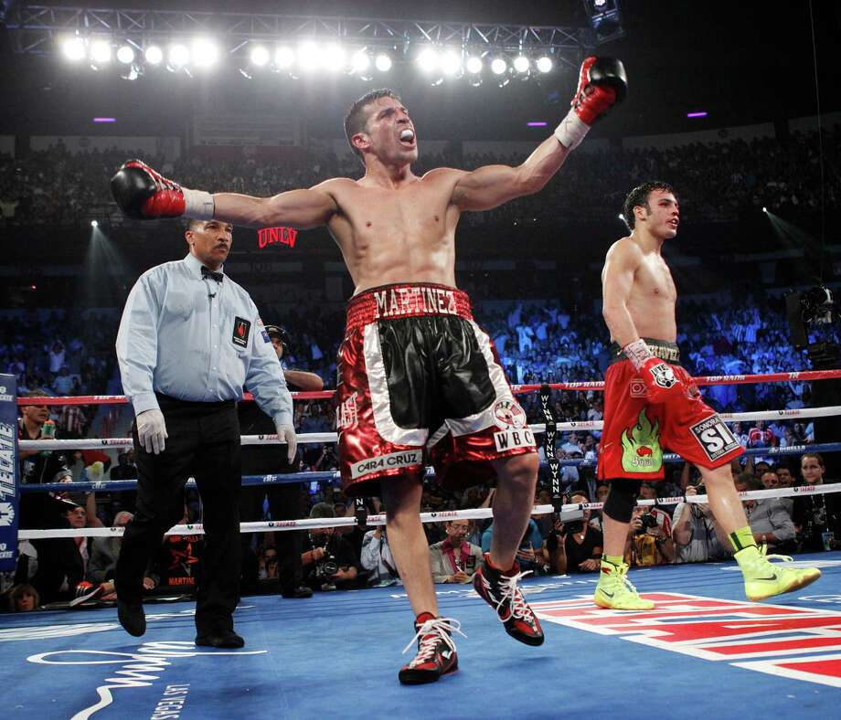Sergio Martinez celebrates near the end of his fight with Julio Cesar Chavez Jr. in their WBC Middleweight Title bout at the Thomas & Mack Center in Las Vegas Saturday, Sept. 15, 2012. (AP Photo/Las Vegas Review-Journal, John Locher) Photo: John Locher, Associated Press / Las Vegas Review-Journal