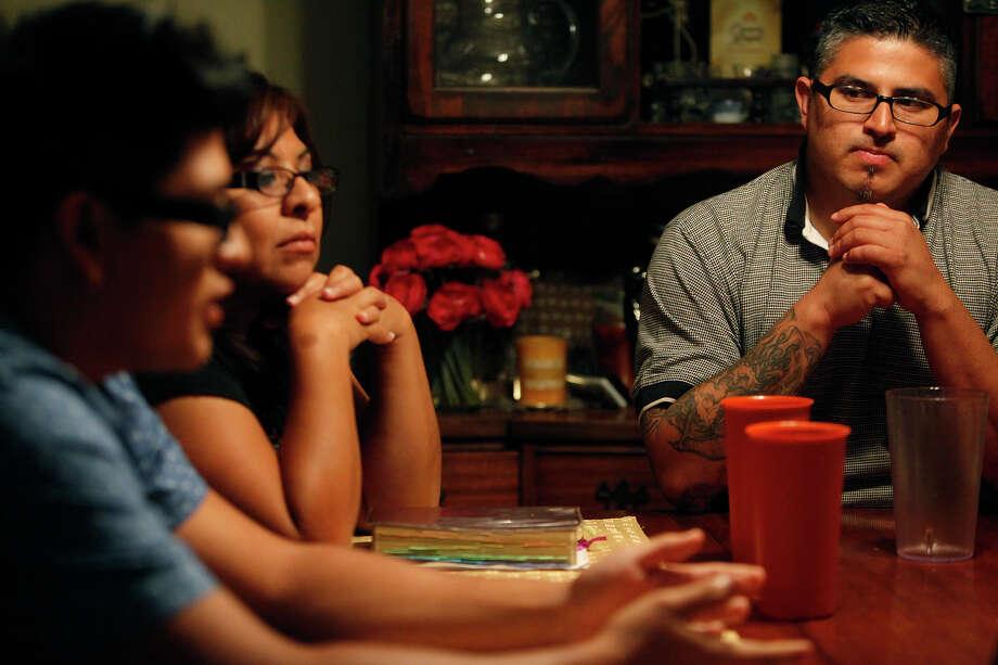 Rebekah Ramos, son Matthew Cardenas (left) and husband Albert Guevara faced tough times because of illness. Photo: Lisa Krantz, San Antonio Express-News / San Antonio Express-News