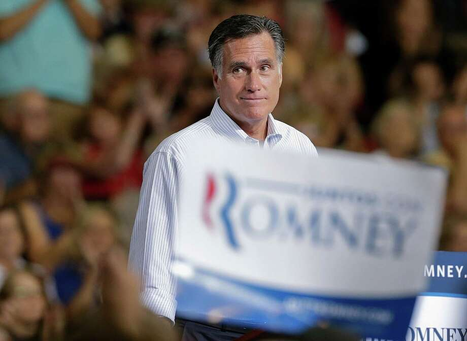 Republican presidential candidate and former Massachusetts Gov. Mitt Romney pauses as supporters cheer to remarks during a rally Friday, Sept. 21, 2012, in Las Vegas. (AP Photo/Julie Jacobson) Photo: Julie Jacobson