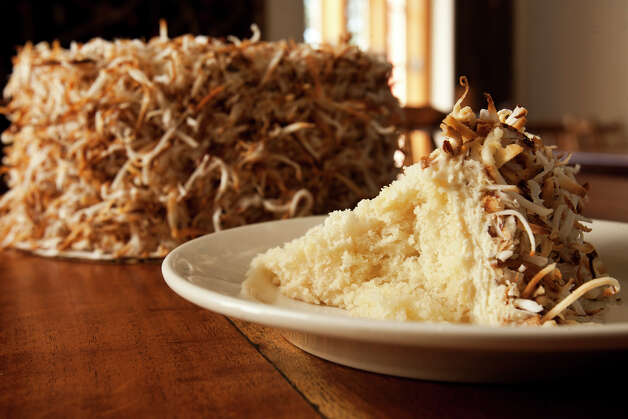 A must-have at Southtown's Liberty Bar, 1111 S. Alamo St., is the celebrated coconut cake. Photo: SALLY FINNERAN, E-N Archive / sfinneran@express-news