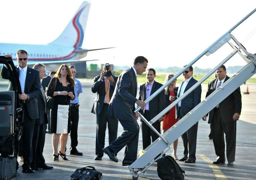 US Republican presidential candidate Mitt Romney boards his plane at Love Field airport in Dallas,Te