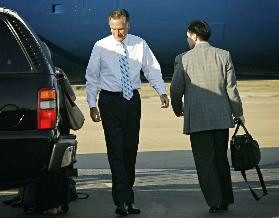 Republican presidential candidate and former Massachusetts Gov. Mitt Romney prepares to depart Dallas Love Field Wednesday, Sept. 19, 2012 following a fundraising stop in Dallas the day before. Photo: G.J. McCarthy, Associated Press / The Dallas Morning News