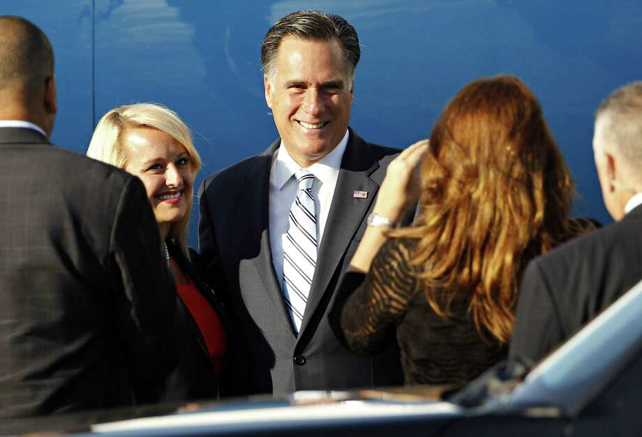 Republican presidential candidate and former Massachusetts Gov. Mitt Romney poses for pictures with supporters, before boarding his campaign charter plane at Love Field in Dallas, Wednesday, Sept. 19, 2012. Photo: G.J. McCarthy, Associated Press / The Dallas Morning News