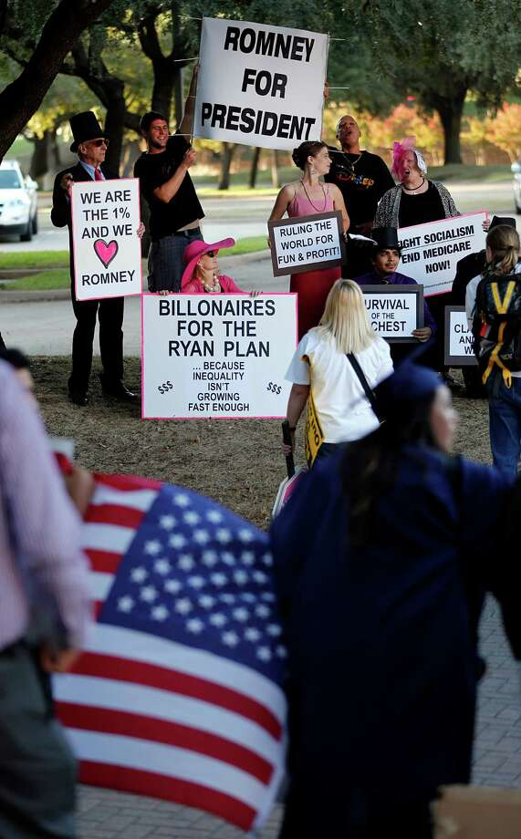 A pair of Mitt Romney supporters, top, are surrounded by protestors against Republican Presidential Candidate Mitt Romney, who was holding private fundraiser at the Hilton Anatole hotel in Dallas on Tuesday, Sept. 18, 2012. Photo: Tom Fox, Associated Press / The Dallas Morning News