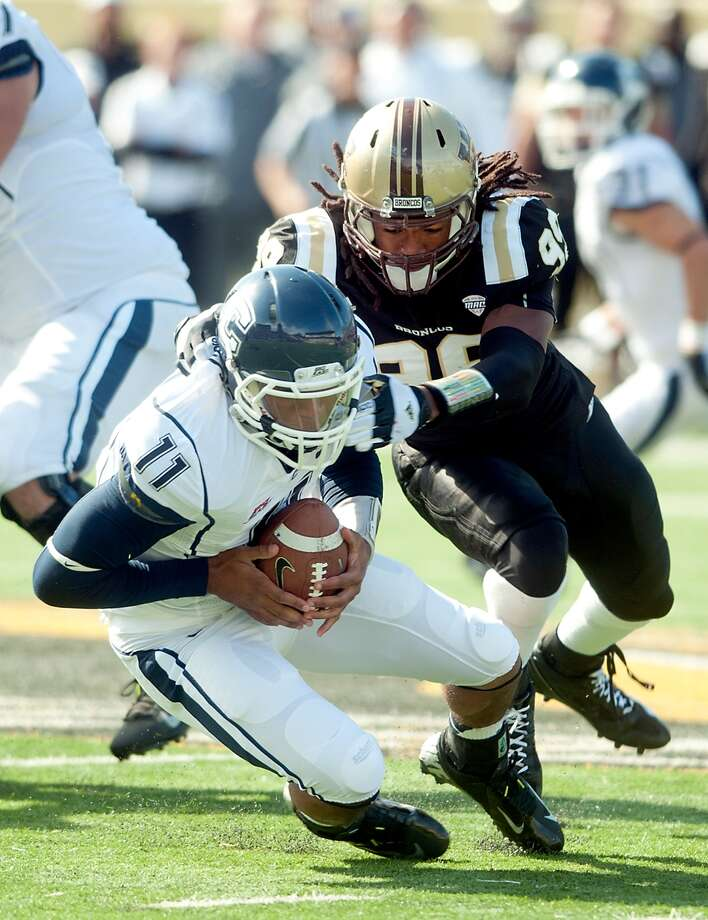 Connecticut's quarterback Scott McCummings recovers his own fumble as Western Michigan's Paul Hazel gets the sack during an NCAA college football game Saturday, Sept. 22, 2012 at Waldo Stadium in Kalamazoo, Mich.  (AP Photo/The Kalamazoo Gazette, Erik Holladay) Photo: Erik Holladay, Associated Press / The Kalamazoo Gazette