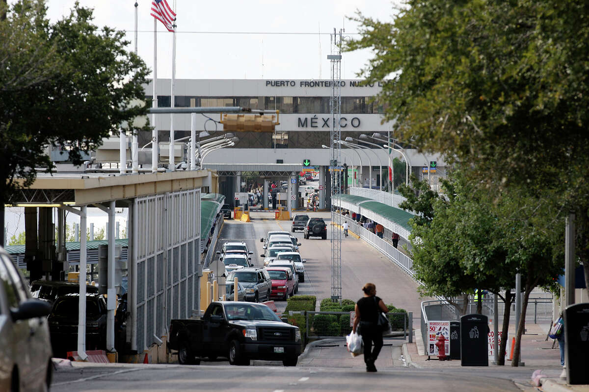 U.S.-bound traffic is light as the day starts in downtown Laredo. Crossing the bridge has become a time-consuming activity.