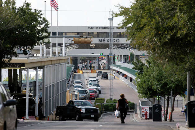U.S.-bound traffic is light as the day starts in downtown Laredo. Crossing the bridge has become a time-consuming activity. Photo: Jerry Lara, San Antonio Express-News / © 2012 San Antonio Express-News