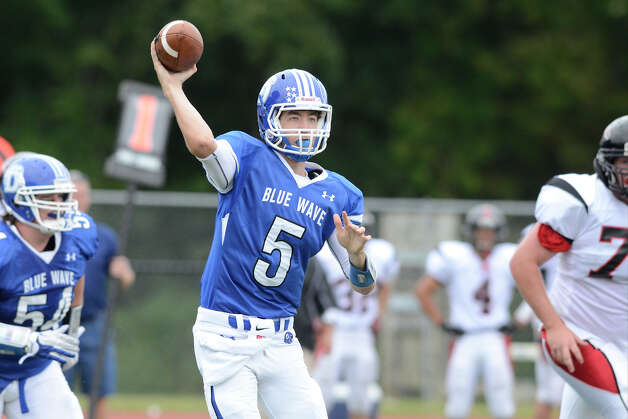 Darien's $5 Henry Baldwin throws a pass as Darien High School hosts Fairfield Warde High School in varsity football in Darien, CT on Sept. 22, 2012. Photo: Shelley Cryan / Shelley Cryan for the Stamford Advocate/ freelance Shelley Cryan