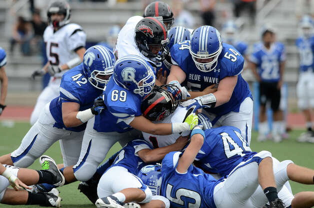 Warde's #1 Colin Ventura is surrounded as Darien High School hosts Fairfield Warde High School in varsity football in Darien, CT on Sept. 22, 2012. Photo: Shelley Cryan / Shelley Cryan for the Stamford Advocate/ freelance Shelley Cryan
