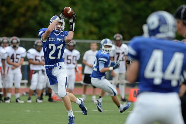 Darien's #21 Nicholas Lombardo pulls down a pass as Darien High School hosts Fairfield Warde High School in varsity football in Darien, CT on Sept. 22, 2012. Photo: Shelley Cryan / Shelley Cryan for the Stamford Advocate/ freelance Shelley Cryan