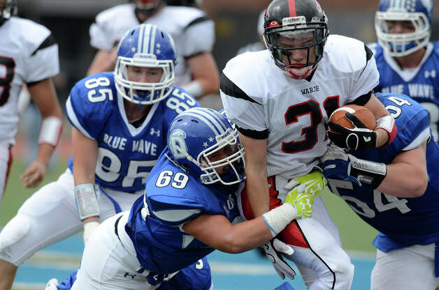 Warde's #31 T.J. Gallagher gains some yardage as Darien High School hosts Fairfield Warde High School in varsity football in Darien, CT on Sept. 22, 2012. Photo: Shelley Cryan / Shelley Cryan for the Stamford Advocate/ freelance Shelley Cryan