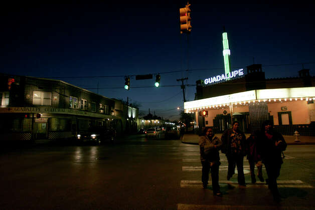 The Guadalupe Theater is lit up as a meeting of the Guadalupe Cultural Center Board of Directors is underway on Thursday, March 23, 2006. Photo: Lisa Krantz, San Antonio Express-News / SAN ANTONIO EXPRESS-NEWS
