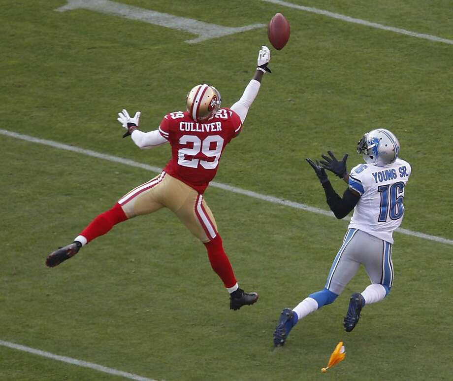 San Francisco 49ers defensive back Chris Culliver, left, breaks up a pass intended for Detroit Lions wide receiver Titus Young, right, during the first quarter of an NFL football game in San Francisco, Sunday, Sept. 16, 2012. An interference penalty was called on the play. (AP Photo/Tony Avelar) Photo: Tony Avelar, Associated Press
