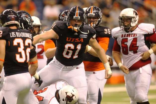 UTSA's Richard Burge (61) after a tackle against Northwestern Oklahoma State at the Alamodome on Saturday, Sept. 22, 2012. (SAN ANTONIO EXPRESS-NEWS)