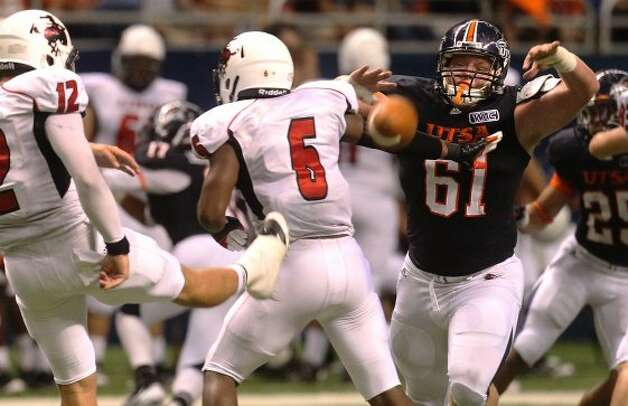 UTSA's Richard Burge attempts to block a punt by Northwestern Oklahoma State's Kyle Jech (12) at the Alamodome on Saturday, Sept. 22, 2012. (SAN ANTONIO EXPRESS-NEWS)