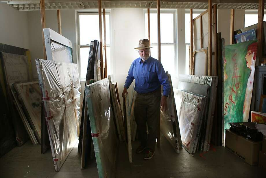 Legendary poet, artist, and publisher Lawrence Ferlinghetti pulling out one of his paintings at his art studio in San Francisco, Calif., on Monday, September 10, 2012. Photo: Liz Hafalia, The Chronicle