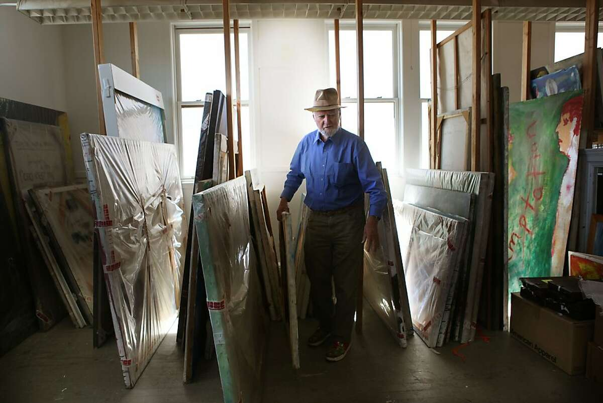 Legendary poet, artist, and publisher Lawrence Ferlinghetti pulling out one of his paintings at his art studio in San Francisco, Calif., on Monday, September 10, 2012.