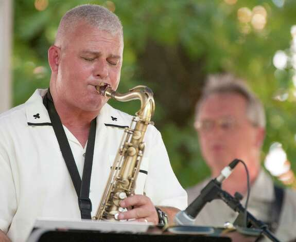 Steve Mohacey, of the jazz group Ulterior Motive, plays his tenor saxophone at Jazz'SAlive, Saturday, Sept. 22, 2012, at Travis Park in San Antonio. Photo: Darren Abate, For The Express-News
