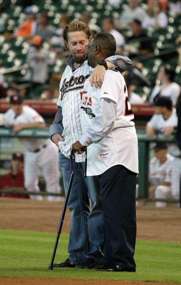 Jeff Bagwell gives Jimmy Wynn a hug during the Astros 50th Anniversary ceremony before the start of an MLB baseball game at Minute Maid Park on Saturday, Sept. 22, 2012, in Houston. Photo: Karen Warren, Houston Chronicle / © 2012  Houston Chronicle