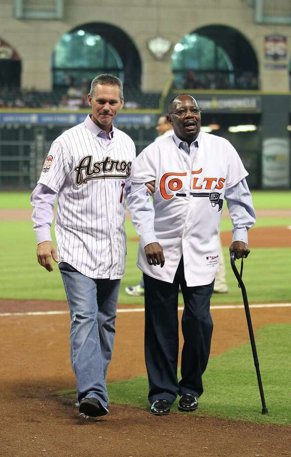 Craig Biggio helps Jimmy Wynn off the field after the Astros 50th Anniversary ceremony before the start of an MLB baseball game at Minute Maid Park on Saturday, Sept. 22, 2012, in Houston. Photo: Karen Warren, Houston Chronicle / © 2012  Houston Chronicle