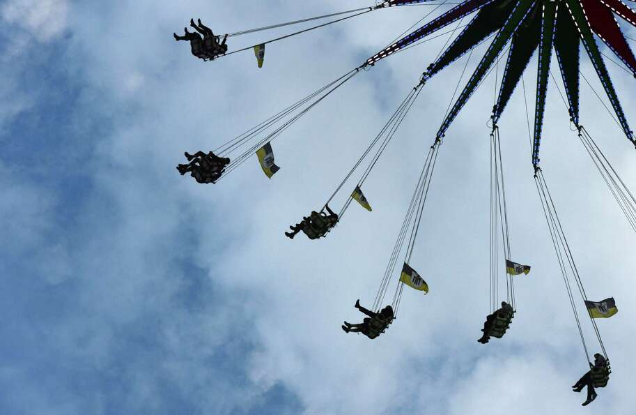 Festival-goers ride a carnival ride during Oktoberfest at the Theresienwiese in Munich, southern Ger
