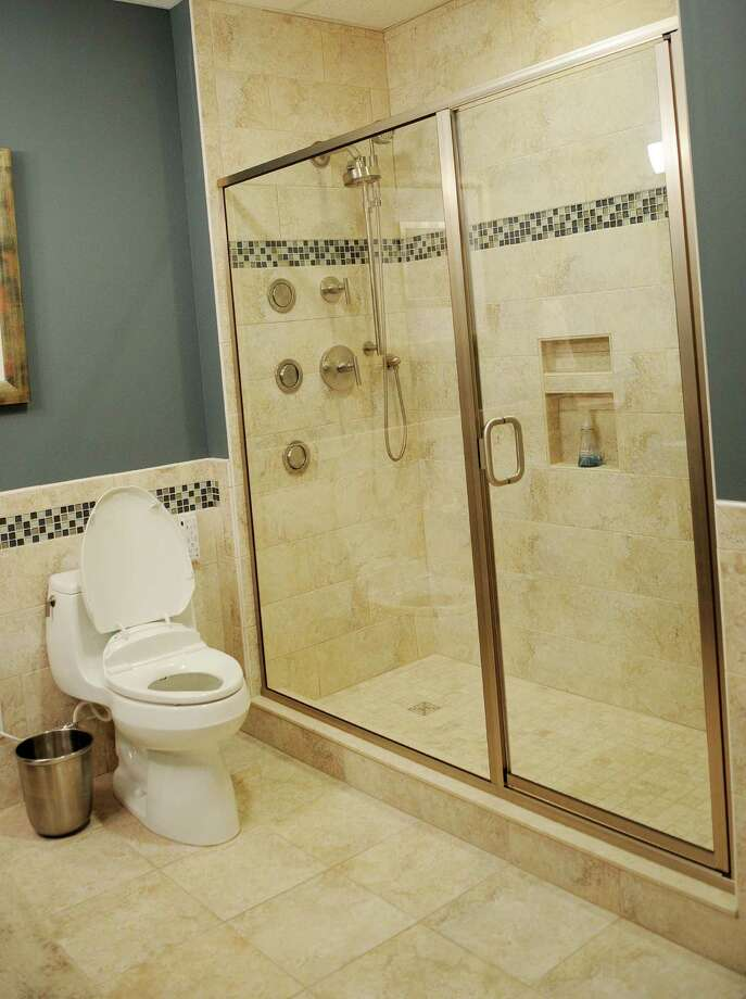 This is a detail of a shower with multiple fixtures, custom tile, door and a built in area for bath products in a model bathroom in the design center, at 17 Chapel, Boutique Condominiums, on the corner of Monroe St. on Wednesday, Nov. 17, 2010, in Albany, NY, and of course an available option when selecting options when designing your condo.  Photos for a future Real Estate Section Open House Feature, on shower and tub details. (Times Union Archives) Photo: Luanne M. Ferris / 00011094A