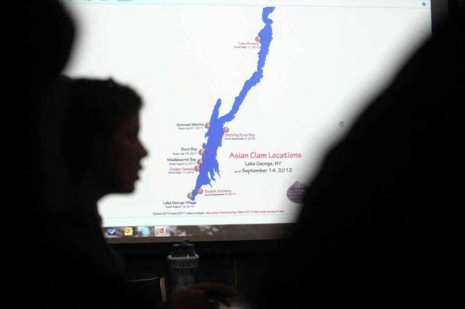 A map showing where on the lake Asian clams have been found is seen on a screen during a meeting of the Asian Clam task force on Thursday, Sept. 20, 2012 at The Lake George Association headquarters in Lake George, NY.  (Paul Buckowski / Times Union) Photo: Paul Buckowski