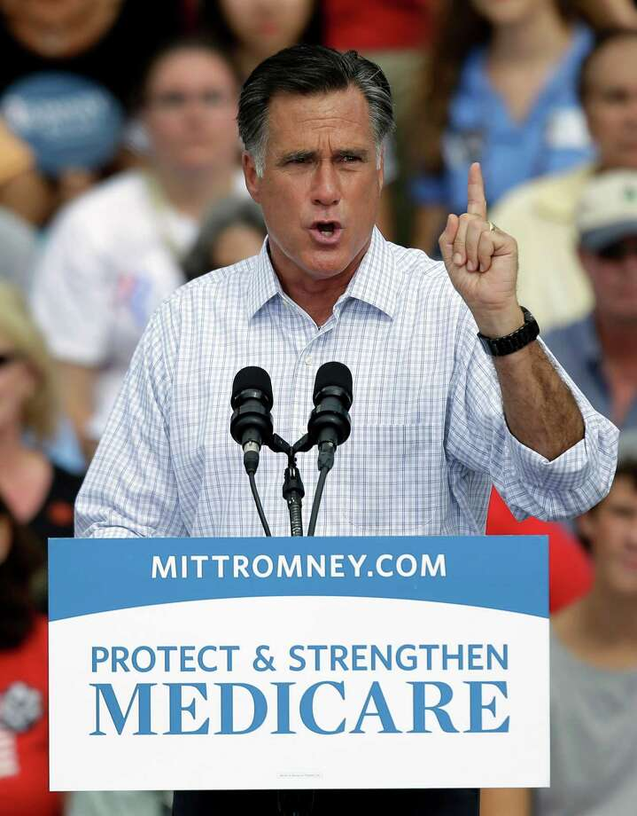 Republican presidential candidate Mitt Romney and former Massachusetts governor gestures during a campaign rally Thursday, Sept. 20, 2012, in Sarasota, Fla. (AP Photo/Chris O'Meara) Photo: Chris O'Meara