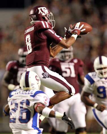 Texas A&M University wide receiver Thomas Johnson (8) makes a midfield catch for a first down as South Carolina State University defensive back Dominique Mitchell (26) covers during the second quarter of a NCAA football game, Saturday, Sept. 22, 2012, in College Station. Photo: Nick De La Torre, Houston Chronicle / © 2012 Houston Chronicle