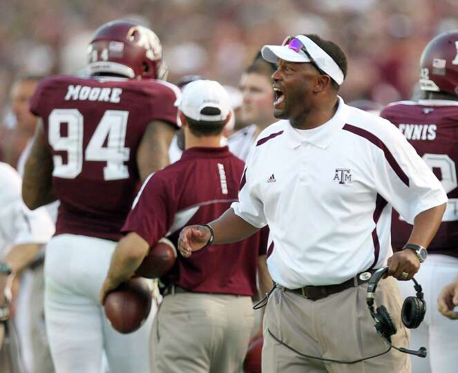 Texas A&M University heach coach Kevin Sumlin yells instructions to his players during the second qu