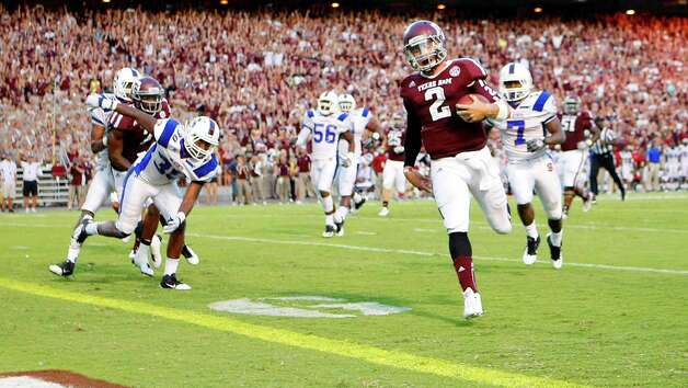 Texas A&M University quarterback Johnny Manziel (2) breaks away from the South Carolina State University defense for a touchdown during the second quarter of a NCAA football game, Saturday, Sept. 22, 2012, in College Station. Photo: Nick De La Torre, Houston Chronicle / © 2012 Houston Chronicle