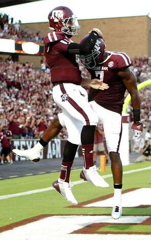 Texas A&M University wide receiver Uzoma Nwachukwu (7) celebrates his touchdown run with Texas A&M University wide receiver Uzoma Nwachukwu (7) during the second quarter of a NCAA football game, Saturday, Sept. 22, 2012, in College Station. Photo: Nick De La Torre, Houston Chronicle / © 2012 Houston Chronicle