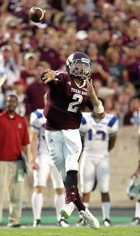 Texas A&M University quarterback Johnny Manziel (2) throws the ball to an open receiver in the South Carolina State University defense during the second quarter of a NCAA football game, Saturday, Sept. 22, 2012, in College Station. Photo: Nick De La Torre, Houston Chronicle / © 2012 Houston Chronicle