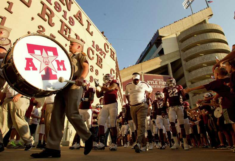 Texas A&M University head coach kevin Sumlin leads his team to the tunnel before his football game a