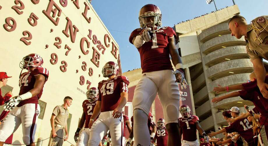 Texas A&M University defensive back De'Vante Harris (1) greets Texas A&M University fans as he and his teammates walk to the tunel before a NCAA football game against South Carolina State University, Saturday, Sept. 22, 2012, in College Station. Photo: Nick De La Torre, Houston Chronicle / © 2012 Houston Chronicle