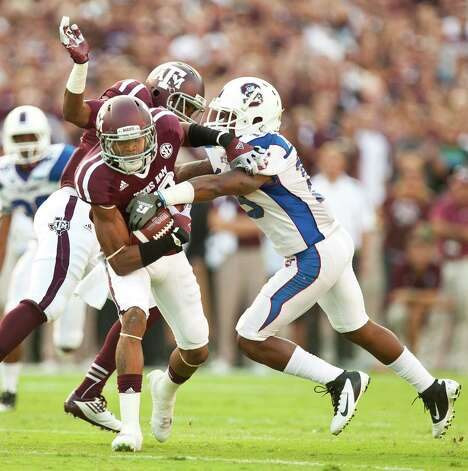 Texas A&M University kick returner Dustin Harris (22) avoids a collision with Texas A&M University defensive back Desmond Gardiner (6) and quarter South Carolina State University defensive back Josh McFadden (19) during the first quarter of a NCAA football game, Saturday, Sept. 22, 2012, in College Station. Photo: Nick De La Torre, Houston Chronicle / © 2012 Houston Chronicle