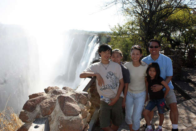 From left, Stephen, Julia, Anna, Ken and Christine Song at Victoria Falls in southern Africa. Photo: Contributed Photo