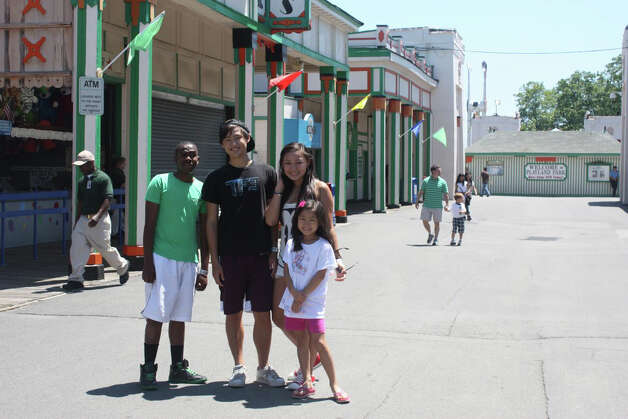 From left, Nkosi Khoza at Rye Playland in New York with Stephen, Julia and Christine Song. Photo: Contributed Photo
