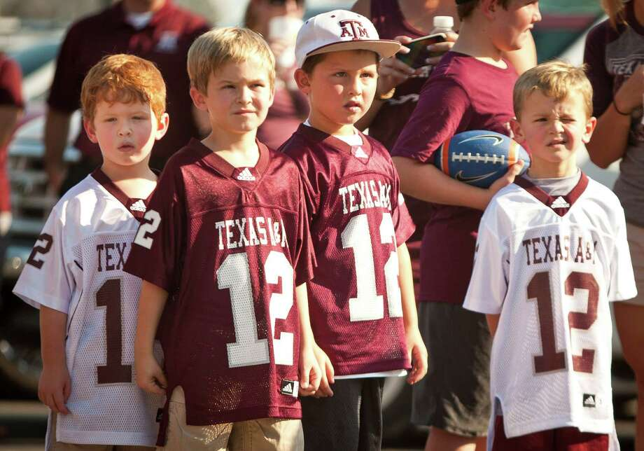 From left; Landon Richards, 5, his brother Trent Richards, 7, his friend Blake Beheler, 6, and cousin Carter Richards, 5, all of Sugar Land, watch the Corp of Cadets file into Kyle field before a NCAA football game between Texas A&M University and South Carolina State University, Saturday, Sept. 22, 2012, in College Station. Photo: Nick De La Torre, Houston Chronicle / © 2012 Houston Chronicle