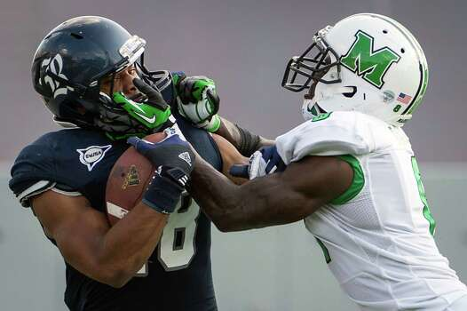 Rice running back Brandon Hamilton is pushed out of bounds by Marshall defensive back Keith Baxter during the fourth quarter of a college football game at Rice Stadium, Saturday, Sept. 22, 2012, in Houston. Photo: Smiley N. Pool, Houston Chronicle / © 2012  Houston Chronicle