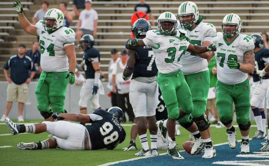 Marshall running back Kevin Grooms (37) celebrates after scoring the winning touchdown during the overtime in a college football game at Rice Stadium, Saturday, Sept. 22, 2012, in Houston. Marshal won the game 54-51. Photo: Smiley N. Pool, Houston Chronicle / © 2012  Houston Chronicle