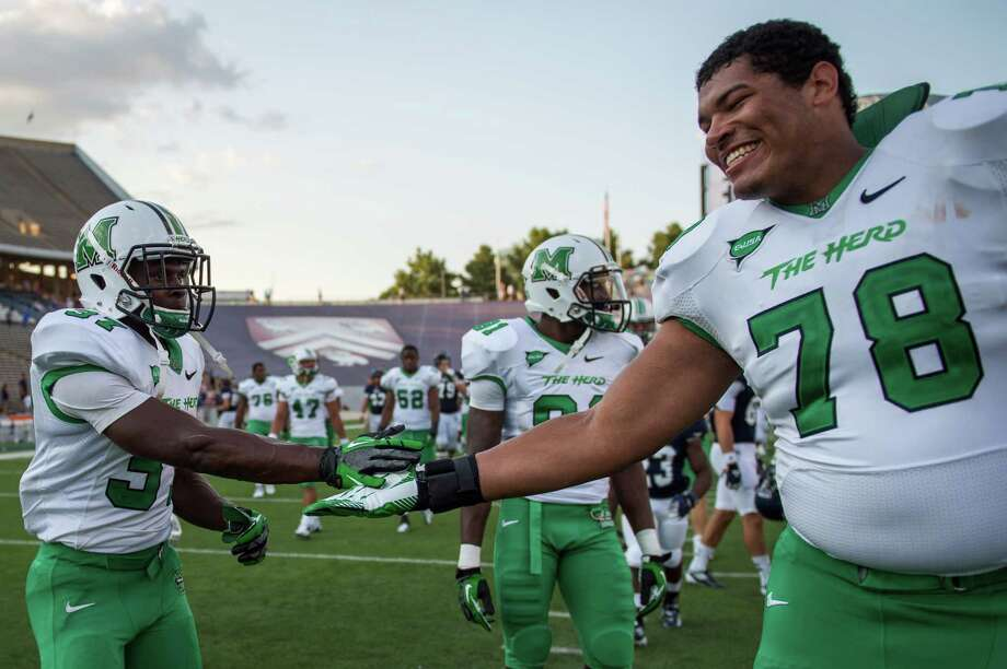 Marshall running back Kevin Grooms (37) celebrates celebrates with offensive linesman Clint Van Horn (78) after a college football game at Rice Stadium, Saturday, Sept. 22, 2012, in Houston. Grooms scored the winning touchdown in overtime as Marshal won the game 54-51. Photo: Smiley N. Pool, Houston Chronicle / © 2012  Houston Chronicle